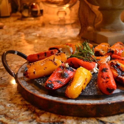 A surprisingly simple way to impress your dinner guests. Grilled Mini Peppers Stuffed With Herbed Cheese | Recipe By www.AfterOrangeCounty.com