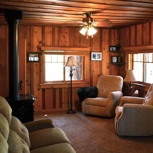 My log cabin living room renovation after orange county for Lodge style living room furniture