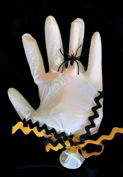 A DIY IDEA FOR SPECIAL HALLOWEEN TREATS | Scary Gloved Hand Full of Halloween Candy | www.AfterOrangeCounty.com