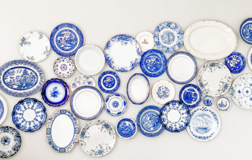 TOUR OUR CHARMING MAINE VACATION COTTAGE | Blue and White China Wall Display | www.AfterOrangeCounty.com